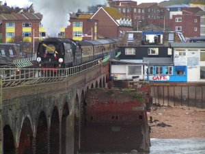 The express is hauled back across the harbour by a class 67 diesel with Tangmere at the tail