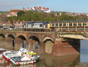 37601 sits on the viaduct across Folkestone Harbour with St Peter's church visible on the hillside beyond