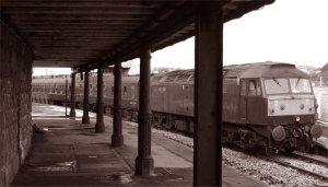 West Coast Railways Class 47 diesel 47787 seen through the columns of Folkestone Harbour station