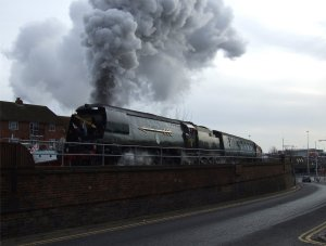 Southern Region Battle of Britain class 4-6-2 no. 34067 Tangmere tackles the 1-in-30 ascent that runs parallel to the Tram Road