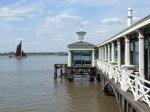 A barge sails past the Town Pier