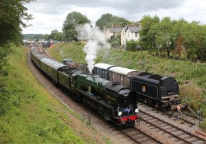Rebuilt Battle of Britain class locomotive 34059 Sir Archibald Sinclair passes Railway Cottages