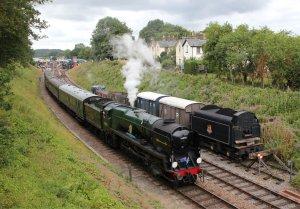 Rebuilt Battle of Britain class locomotive 34059 Sir Archibald Sinclair passes Railway Cottages