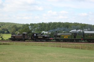 A triple header formed of Terrier's 672 'Fenchurch' and 55 'Stepney' with Class E4 473 'Birch Grove' departs from Horsted Keynes