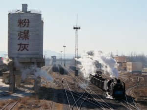 JS 8250 departs Xizhan with the 2pm mixed passenger/freight service