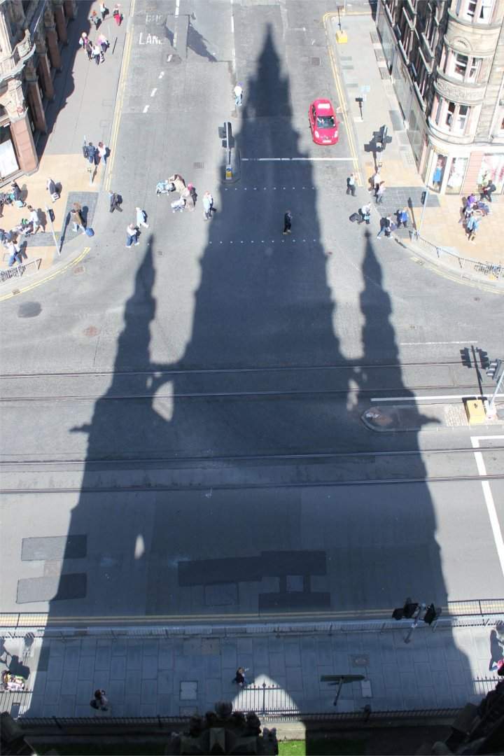 The shadow of the Scott monument falls on Princes Street
