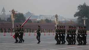 The flag is taken down from Tian'anmen Square at sunset
