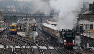 Merchant Navy class 4-6-2 no. 35028 'Clan Line' passes through a wet Norwood Junction on 9th February 2013
