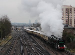 Merchant Navy class 4-6-2 no. 35028 'Clan Line' approaches Goat House Bridge, South Norwood on 9th February 2013