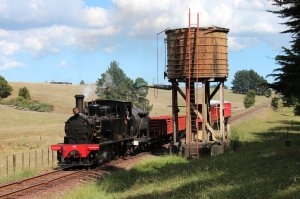 Y542 on a mixed passenger/freight passes a water tower on the Glenbrook Vintage Railway