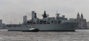 HMS Bulwark heads upriver to take her position at the head of the co-ordinated departure