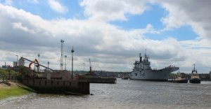HMS Illustrious passes Delta Wharf on her way to her mooring in Greenwich