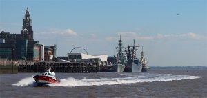 Liverpool Pilot 'Turnstone' passes HMCS Iroquois and ORP Generał Tadeusz Kościuszko