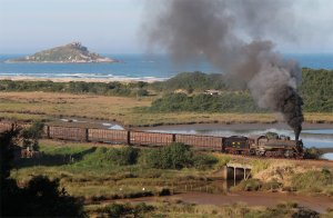Santa Fe no. 205 hauls a steam freight from Imbituba past the Lagoa de Paes Leme