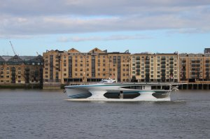 MS Tûranor PlanetSolar passes Metropolitan Wharf, Wapping, as she heads upstream