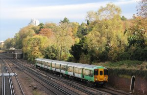 A Southern class 455 electric multiple unit passes through South Croydon about 40 minutes earlier