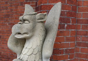 A griffin guards the entrance to the Mansion