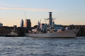 HMS Argyll turns 180 degrees with the assistance of two tugs