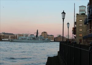 HMS Argyll passes Globe Wharf on her departure from London