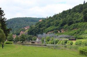 A railway enthusiast watches a steam hauled express pass through Hirschhorn