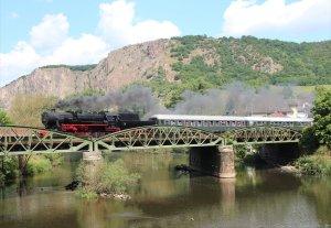 Kriegslok 52 7596 hauls a service across the Nahe at Bad Münster am Stein-Ebernburg on Saturday 31st May 2014