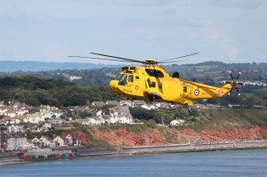 Royal Air Force  Sea King ZH545 against the beautiful backdrop of Dawlish