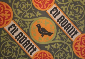 Pugin's wallpaper designs included the family motto 'en avant' (forward)