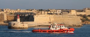 Tug Maria C passes Fort Ricasoli in the golden hour