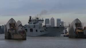 HMS Ocean approaches the Thames Barrier