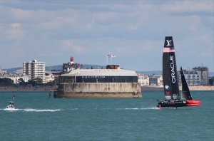 Team Oracle USA flies past Sandbank Fort during the first race of the day