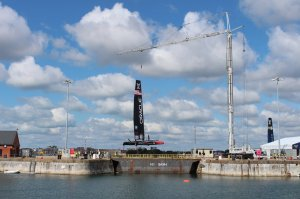 Oracle Team America's AC45 is lifted out from the technical base at No 1 Basin.