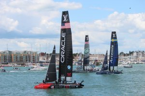 The AC45s of Landrover BAR, Artemis Racing and Oracle Team USA head out of the harbour en route to the race course