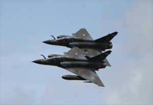 A pair of Mirage 2000N jets from the French Air Force  in the air as Ramex Delta