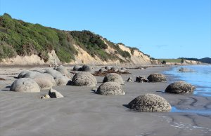 The boulders are scattered across Koekohe Beach