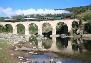 03.12 hauls a light express across the viaduct between Momchilgrad and Kardzhali