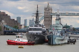 JS Kashima takes up her berth alongside HMS Belfast assisted by tugs ZP Bear and SD Seal
