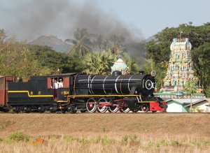 YD964 passes a lineside temple at Thaton